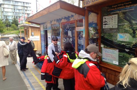 Dockside office check-in and suit up before an open-boat tour